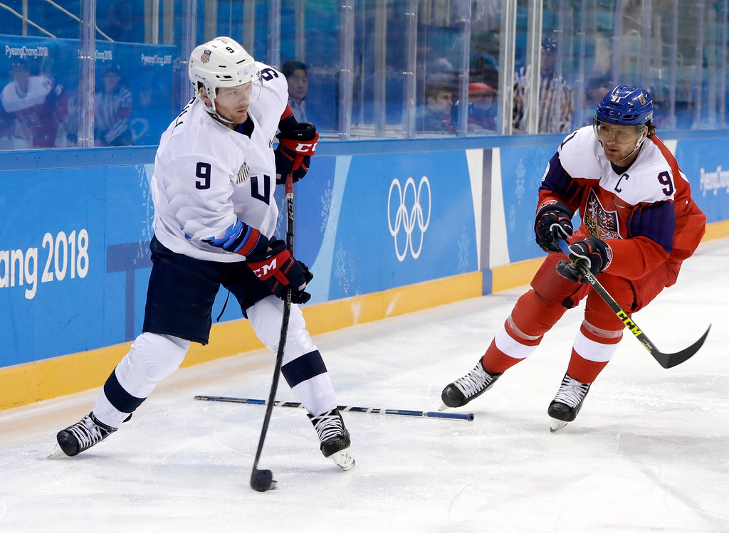 . Brian O\'Neill (9), of the United States, takes a shot against Martin Erat (91), of the Czech Republic, during the first period of the quarterfinal round of the men\'s hockey game at the 2018 Winter Olympics in Gangneung, South Korea, Wednesday, Feb. 21, 2018. (AP Photo/Matt Slocum)