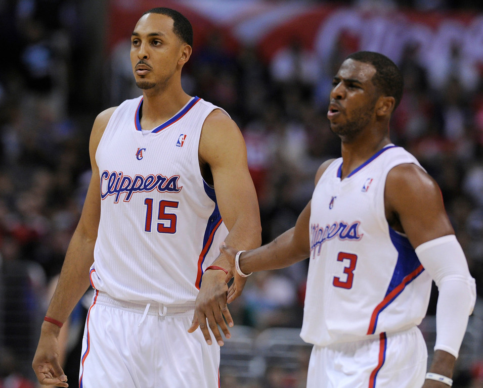 . Clippers#15 Ryan Hollins Chris Paul in the 4th quarter congratulate themselves as the game is well in hand. The Clippers defeated the Minnesota Timberwolves 111-95 in a game played at Staples Center in Los Angeles, CA 4/10/2013(John McCoy/Staff Photographer