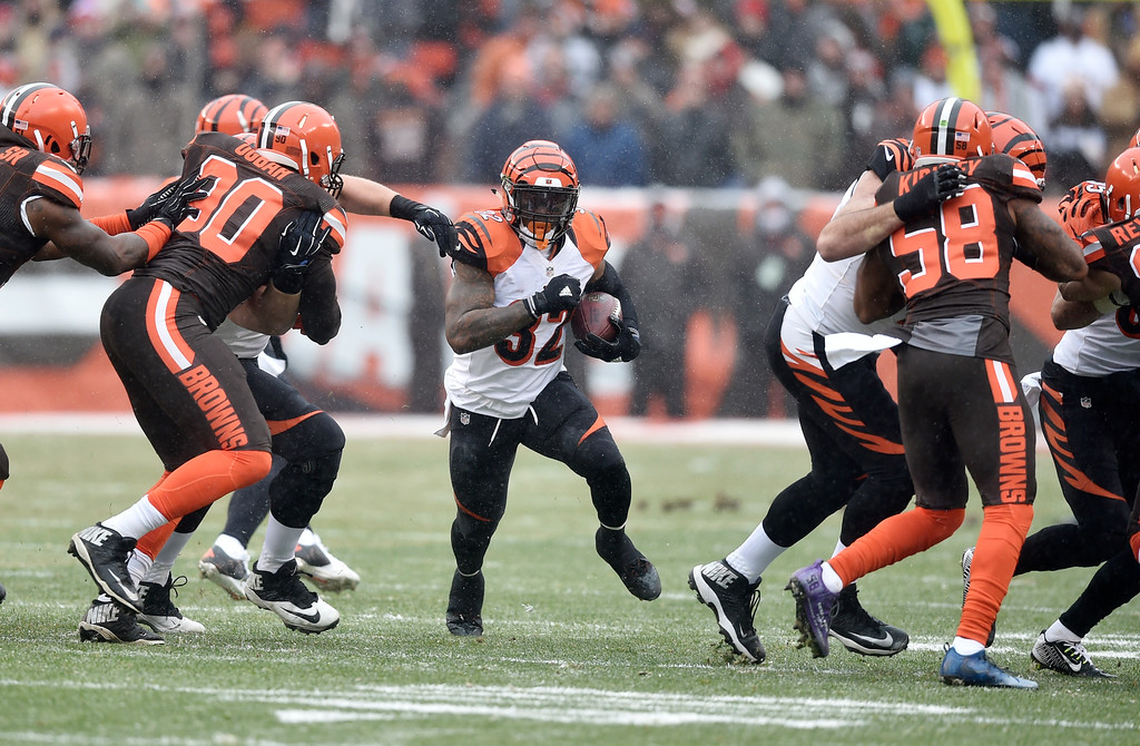 . Cincinnati Bengals running back Jeremy Hill, center, runs the ball in the first half of an NFL football game against the Cleveland Browns, Sunday, Dec. 11, 2016, in Cleveland. (AP Photo/David Richard)