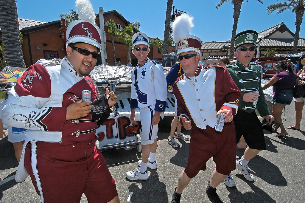 . 08/21/10:  Band members Chris Gomar, Andy Fleck, Ken Williams, and Kevin Williams, from left, with Sgt. Pepper\'s Flying Pianos, of Signal Hill, dance in the hanger waiting for their turn to fly at the Red Bull Flugtag Long Beach at Rainbow Harbor on Saturday, August 21, 2010..Photo by Diandra Jay/Press-Telegram