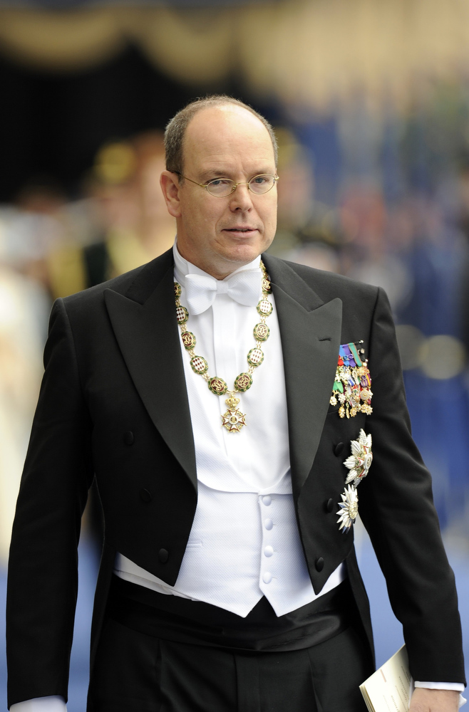 . Prince Albert II of Monaco leaves the Nieuwe Kerk church in Amsterdam after the religious crowning cerminony April 30, 2013. The Netherlands is celebrating Queen\'s Day on Tuesday, which also marks the abdication of Queen Beatrix and the investiture of her eldest son Willem-Alexander.      REUTERS/Toussaint Kluiters/POOL
