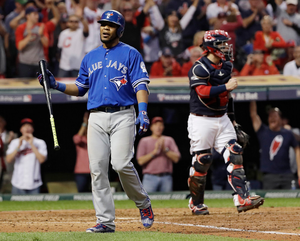 . Toronto Blue Jays\' Edwin Encarnacion, left, reacts after striking out against the Cleveland Indians during the ninth inning in Game 2 of baseball\'s American League Championship Series in Cleveland, Saturday, Oct. 15, 2016. (AP Photo/Matt Slocum)