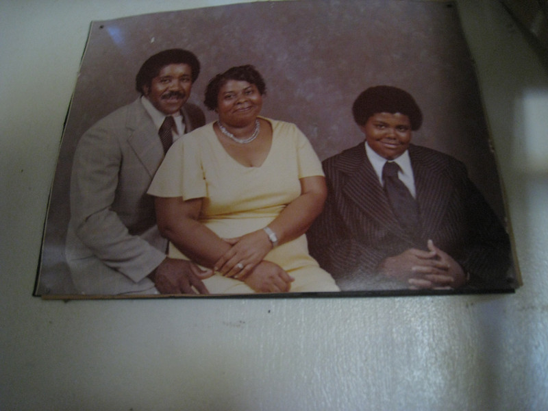 Family photo found on wall of Thomas home. L-R: Alton and Dot Thomas, son Danny.  lcf