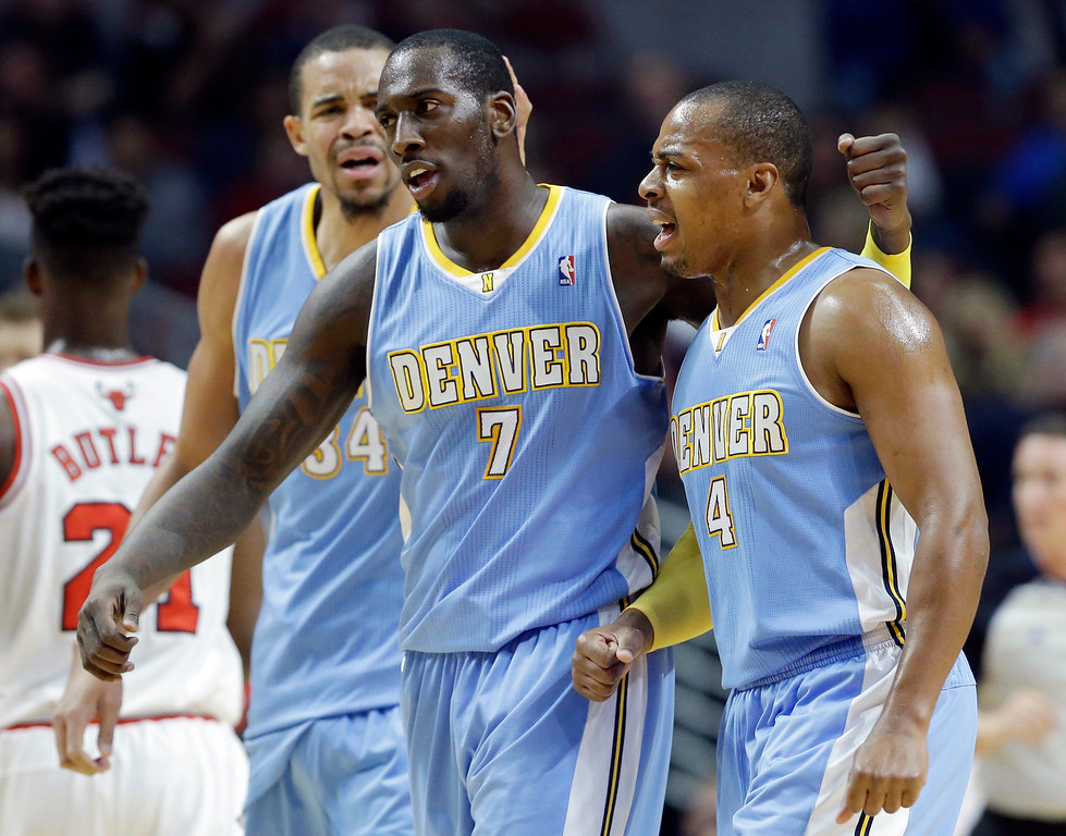 . Denver Nuggets forward JJ Hickson (7) celebrates with guard Randy Foye (4) and center JaVale McGee after scoring a basket during the first half of an NBA preseason basketball game against the Chicago Bulls in Chicago on Friday, Oct. 25, 2013. (AP Photo/Nam Y. Huh)