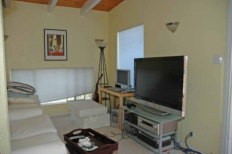"The guest house ""living room"" has an open beam ceiling."