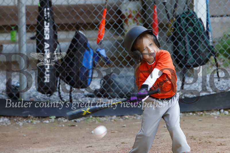 Alexandria Boris takes a big swing in the Saxonburg 4-6 little league game between the Orioles and the Pirates Friday, June 14. Seb Foltz/Butler Eagle