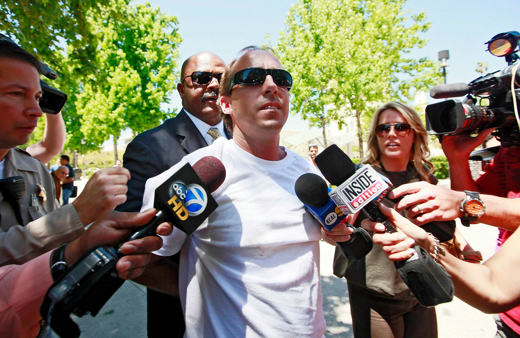 . In this April 27, 2011 file photo, one of Paris Hilton\'s bodyguards, rear, escorts an unidentified assailant after the man grabbed Paris Hilton boyfriend Cy Waits while Waits and Hilton were walking into court  in Los Angeles. Hilton and her then-boyfriend Waits were accosted by James Rainford while they walked in to a courthouse to testify against another man who had broken in to the hotel heiress\' Hollywood Hills home. Hilton\'s security wrestled Rainford to the ground and he was promptly arrested him and he pleaded no contest to misdemeanor battery. Rainford, who was repeatedly arrested outside Hilton\'s residences and asked her to marry him, was ultimately charged with felony stalking and sentenced to probation and psychiatric counseling in April 2012.  (AP Photo/Nick Ut, file)