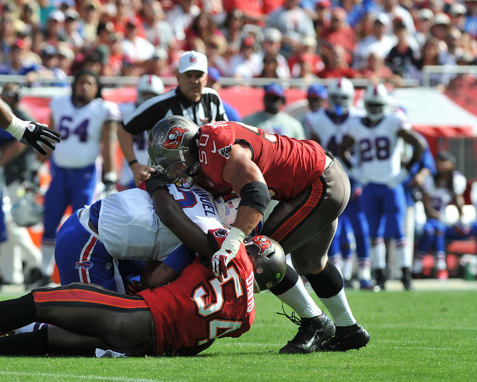 . Linebacker Lavonte David #54 of the Tampa Bay Buccaneers sacks quarterback E. J. Manuel #3 of the Buffalo Bills December 8, 2013 at Raymond James Stadium in Tampa, Florida. (Photo by Al Messerschmidt/Getty Images)