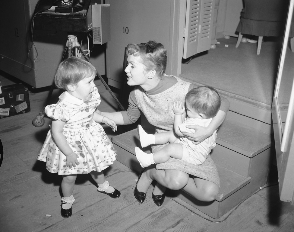". Working long hours on the set of ""Say One For Me,\"" so she can fly to Spain and start another movie, actress Debbie Reynolds is visited at the studio by her children, Carrie 2½, and one-year-old Todd on Feb 27, 1959. Because Debbie has been away from the children so much the last couple of weeks, studio officials arranged to have the youngsters visit their mother during working hours. Debbie plans to leave on March 3 for Madrid. The youngsters will stay with Debbie\'s parents while their actress mother is overseas. (AP Photo)"