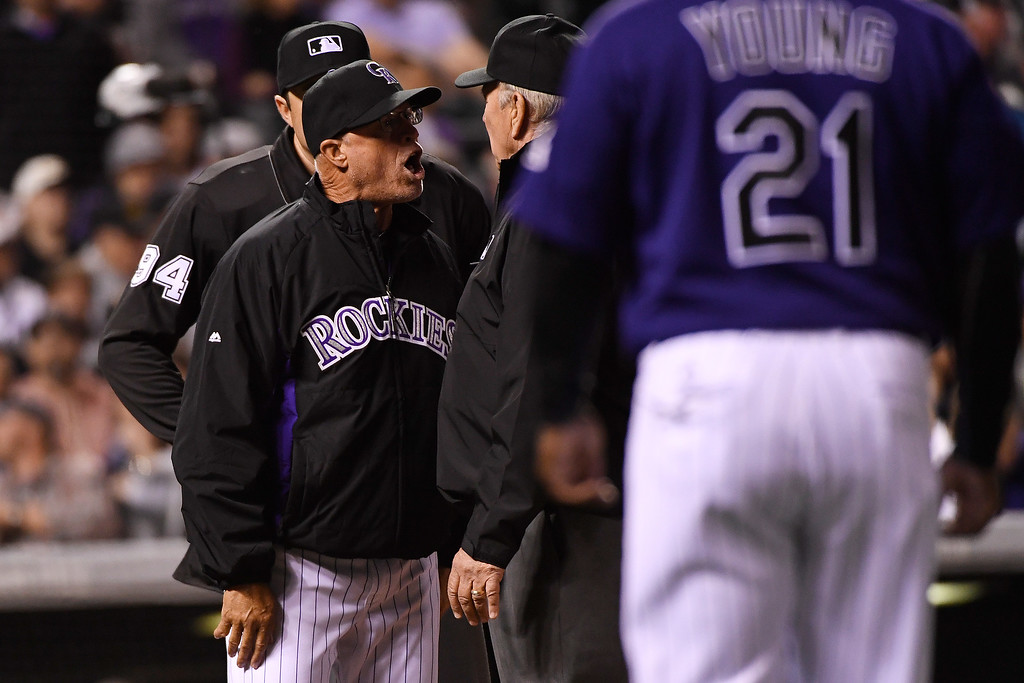 . DENVER, CO - APRIL 25: Colorado Rockies acting manager Tom Runnels argues balls and strikes with the umpiring crew after umpire Lance Barrett (94) ejected Ryan Raburn (6) for arguing the call during the sixth inning at Coors Field. The Colorado Rockies hosted the Pittsburgh Pirates on Monday, April 25, 2016. (Photo by AAron Ontiveroz/The Denver Post)