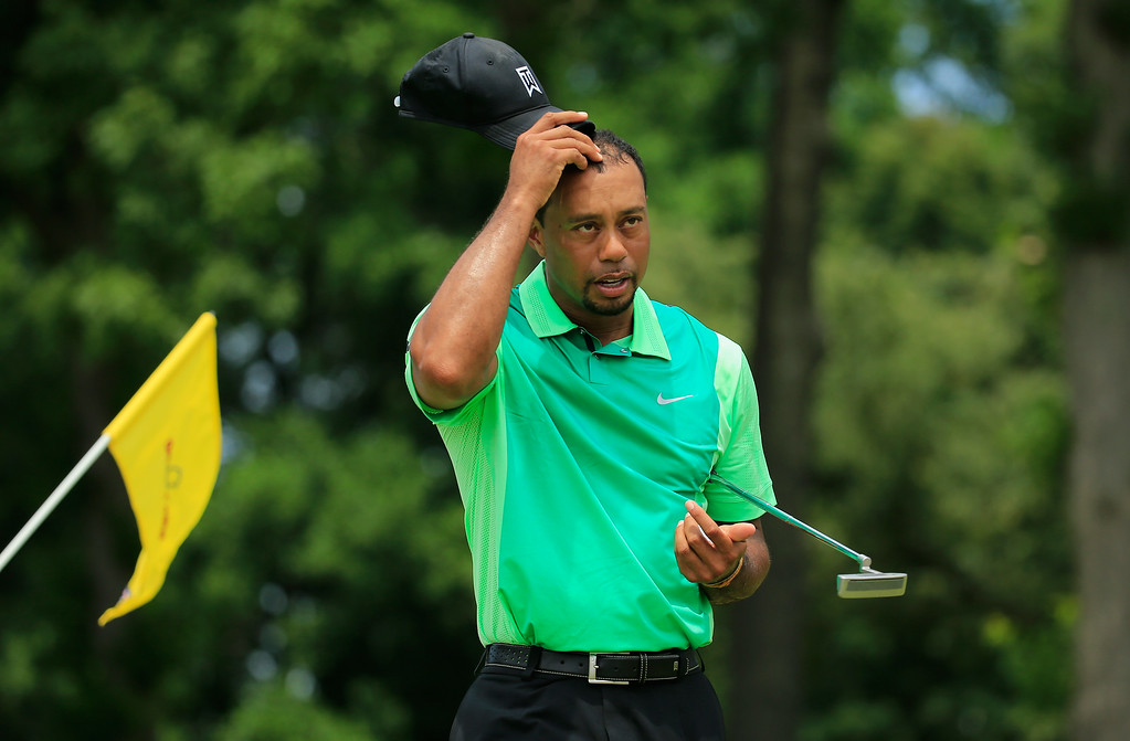 . BETHESDA, MD - JUNE 26: Tiger Woods of the United States walks off the ninth green his final hole of the the first round of the Quicken Loans National at Congressional Country Club on June 26, 2014 in Bethesda, Maryland.  (Photo by Rob Carr/Getty Images)
