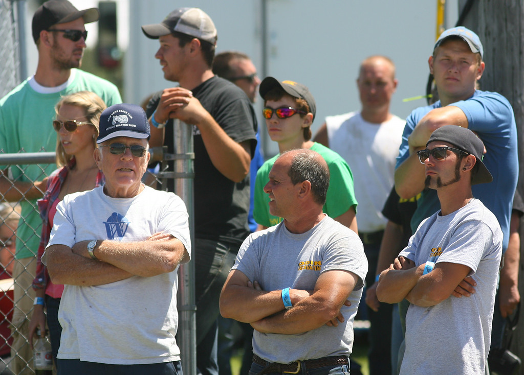. Tractor pull fans look on during the tractor pull competition at the Boonville Oneida County Fair on Thursday, July 24, 2014 in Boonville. The fair runs through Sunday, July 27, 2014. JOHN HAEGER-ONEIDA DAILY DISPATCH @ONEIDAPHOTO ON TWITTER