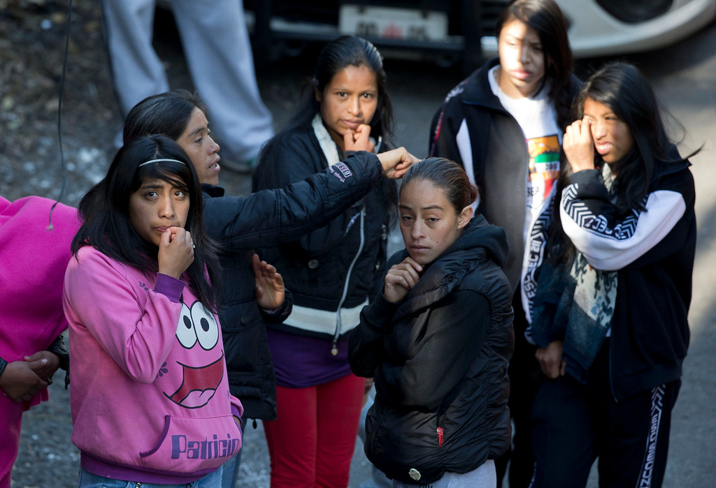 . Relatives and friends wait outside the police cordon where a gas truck exploded at a maternity and children\'s hospital in Cuajimalpa, a Mexico City borough, Thursday, Jan. 29, 2015. A powerful gas tank truck explosion shattered the hospital on the western edge of Mexico\'s capital, killing at least three adults and one baby and injuring dozens. (AP Photo/Rebecca Blackwell)