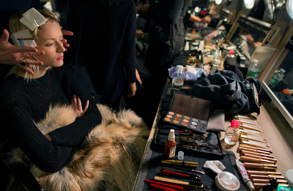 . A model works with a makeup artist before the presentation of the Altuzarra Fall 2013 fashion collection during Fashion Week, Saturday, Feb. 9, 2013, in New York. (AP Photo/Craig Ruttle)