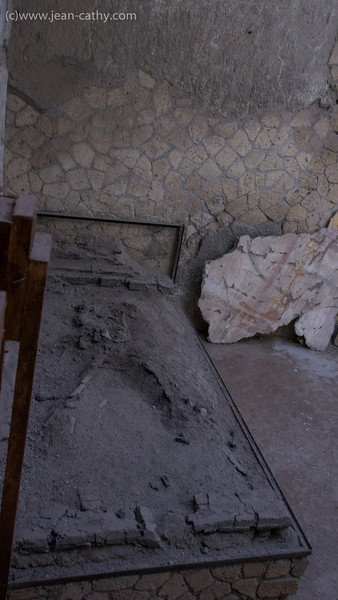 Herculaneum (Ercolano), Italy - This bed was excavated and the remains of the body were left as found.... look carefully you will see his bones. Did choose to go down with his home or was he drunk ... there was a wine cave next door  :)