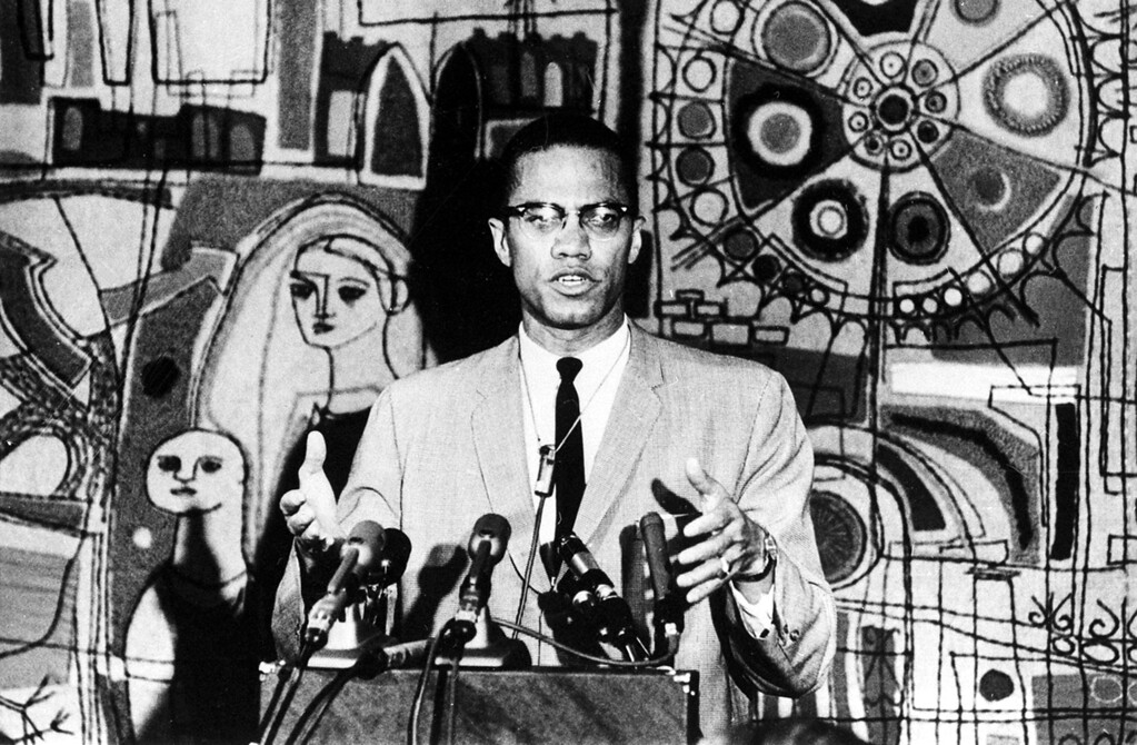 . Malcolm X holds a news conference in the Tapestry Suite of Park Sheraton Hotel in New York City on March 12, 1964.  (AP Photo)