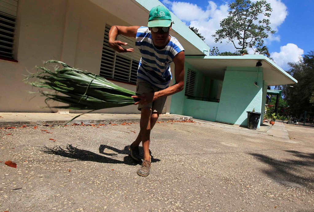 . Julio, who suffers from autism, sweeps the floor at the Dora Alonso School in Havana, Cuba on April 29, 2013. The Dora Alonso School specializes in treating children who suffer from autism spectrum disorders. The building housing the school was a military facility before the 1959 Cuban Revolution, and was inaugurated as a school for children with special needs ten years ago by Cuba\'s former President Fidel Castro.  REUTERS/Enrique De La Osa