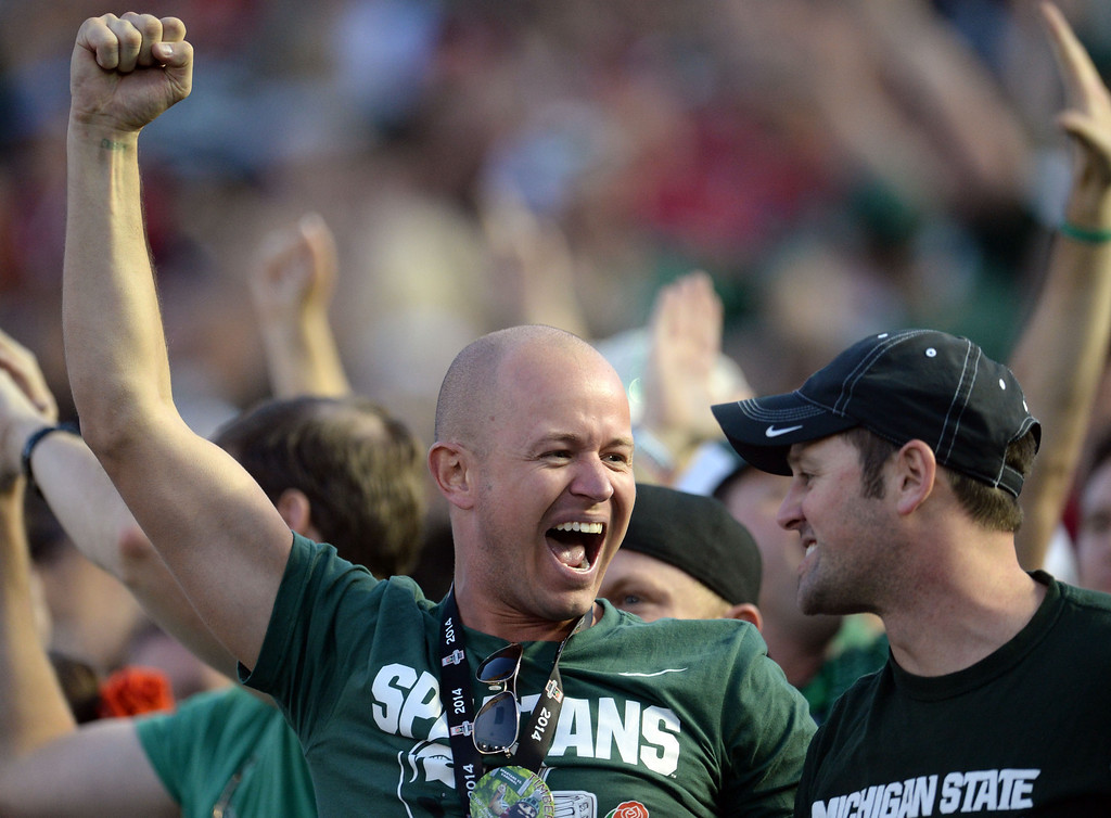 . Michigan State fans facts after a touchdown against Stanford in the second half of the 100th Rose bowl game in Pasadena, Calif., on Wednesday, Jan.1, 2014. Michigan State won 24-20.
