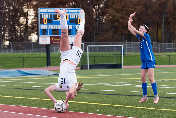 11/07/18 Wesley Bunnell | Staff Southington girl soccer was defeated in PK by Simsbury in a second round Class LL CIAC Tournament game on Wednesday night. Simsbury's Kathryn Rutledge (15) performs a flip throw over Southington's Marisa Imme (5).