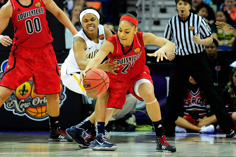 . Tierra Rogers #1 of the California Golden Bears strips the ball from Bria Smith #21 of the Louisville Cardinals during the National Semifinal game of the 2013 NCAA Division I Women\'s Basketball Championship at New Orleans Arena on April 7, 2013 in New Orleans, Louisiana. (Photo by Stacy Revere/Getty Images)