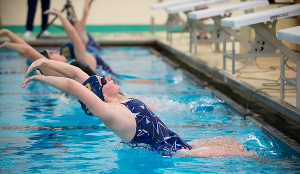 10/02/19 Wesley Bunnell | Staff Bulkeley/HMTCA girls swimming at Newington on Wednesday afternoon. Julia Reniszewski, front, at the beginning of the 100 yard backstroke.