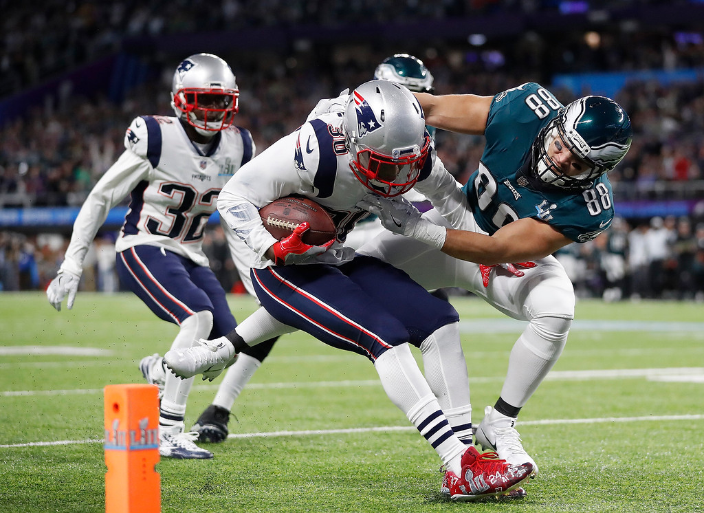 . New England Patriots\' Duron Harmon, center, intercepts a pass during the first half of the NFL Super Bowl 52 football game against the Philadelphia Eagles Sunday, Feb. 4, 2018, in Minneapolis. (AP Photo/Jeff Roberson)