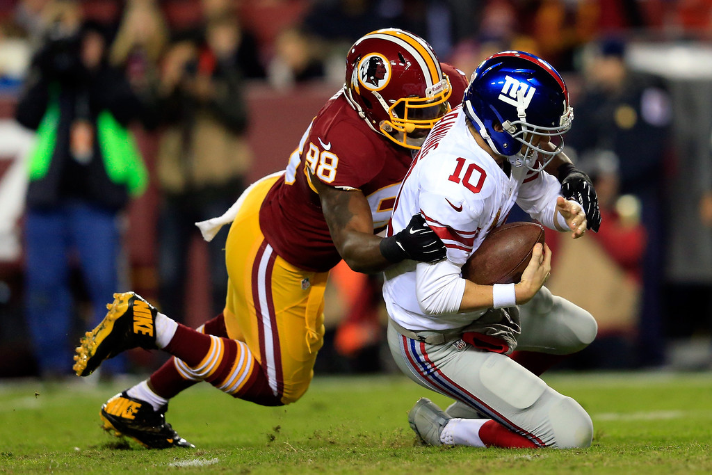 . LANDOVER, MD - DECEMBER 01:  Brian Orakpo #98 of the Washington Redskins sacks Eli Manning #10 of the New York Giants in the first quarter during their game at FedExField on December 1, 2013 in Landover, Maryland.  (Photo by Rob Carr/Getty Images)