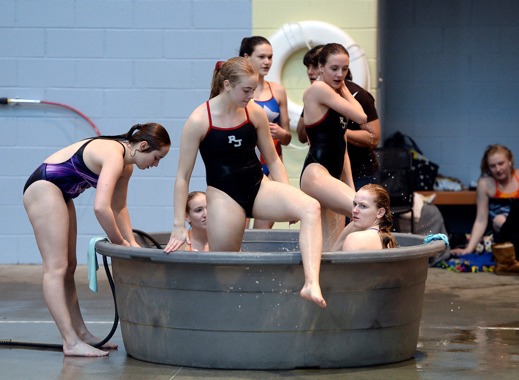 . THORNTON, CO. - FEBRUARY 15, 2014: Divers relaxed in a tub of warm water before competition Saturday. The CHSAA 5A Girl\'s State Swimming Championships wrapped up Saturday night February 14, 2104.  Photo By Karl Gehring/The Denver Post