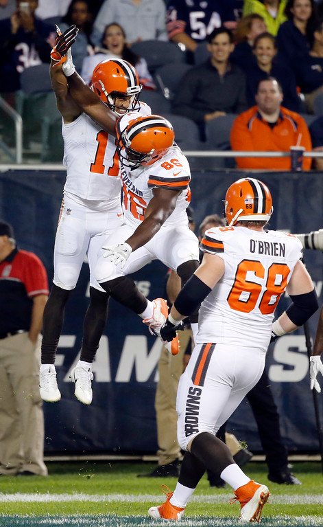 . Cleveland Browns wide receiver Jordan Leslie (11) celebrates a touchdown with tight end Randall Telfer (86) and offensive guard Kitt O\'Brien (68) during the second half of an NFL preseason football game against the Chicago Bears, Thursday, Aug. 31, 2017, in Chicago. (AP Photo/Charles Rex Arbogast)