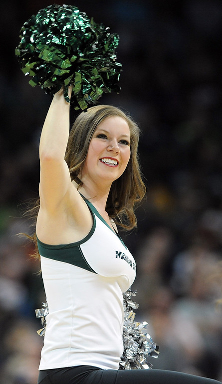 . A Michigan State Spartans cheerleader in action during their game against the Delaware Fightin Blue Hens in the second round of the 2014 NCAA Men\'s Basketball Tournament at Spokane Veterans Memorial Arena on March 20, 2014 in Spokane, Washington.  (Photo by Steve Dykes/Getty Images)