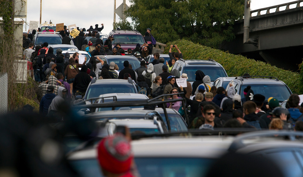 . Demonstrators walk up a freeway offramp from Broadway to Interstate Highway 880 during a protest of the verdict in the Trayvon Martin murder trial last Saturday in Sanford, Fla., Monday, July 15, 2013 in Oakland, Calif. (D. Ross Cameron/Bay Area News Group)