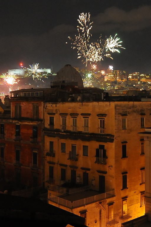 . Fireworks erupt over the Naples skyline in southern Italy on January 1, 2015 to mark New Year\'s celebrations. World cities from Sydney to Dubai rang in the New Year with a spectacular global wave of firework displays.  AFP PHOTO / MARIO LAPORTAMARIO LAPORTA/AFP/Getty Images