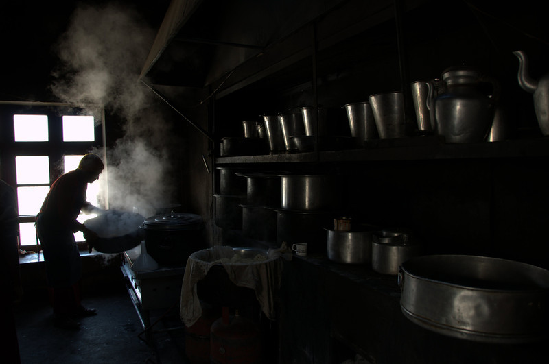 My friend Chamba working in the kitchen of the monastery