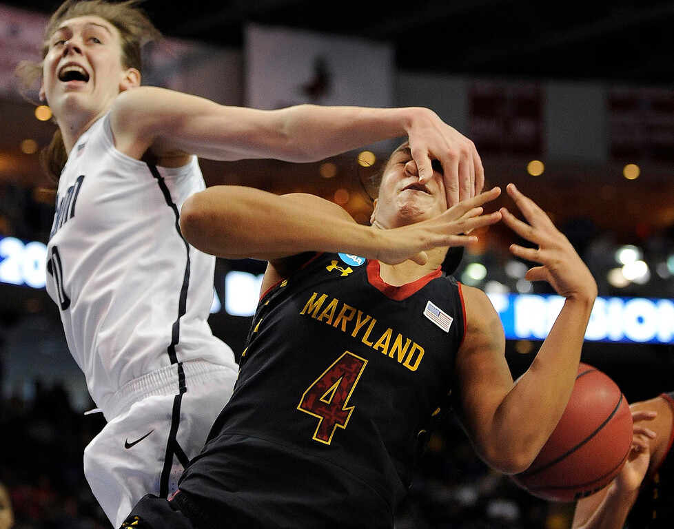 . Connecticut\'s Breanna Stewart, left, fouls Maryland\'s Malina Howard during the second half of a regional semifinal in the NCAA college basketball tournament in Bridgeport, Conn., Saturday, March 30, 2013. Connecticut won 76-50. (AP Photo/Jessica Hill)