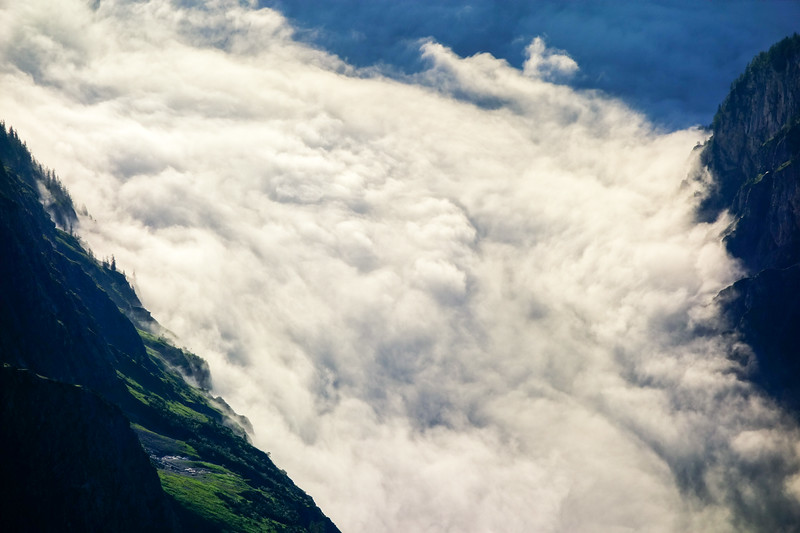 Clouds in the valleys on a brilliant morning at Watzmann Ostwand.