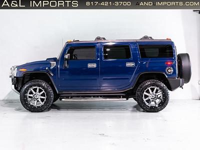 Blue Hummer SUV - 5GRGN23818H102142