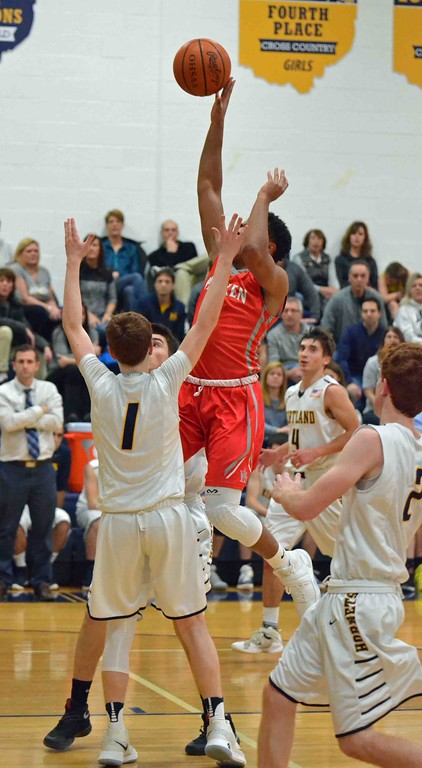 . Paul DiCicco - The News-Herald Hawken�s Ian Burrows drives down the lane and shoots over the Kirtland defenders.