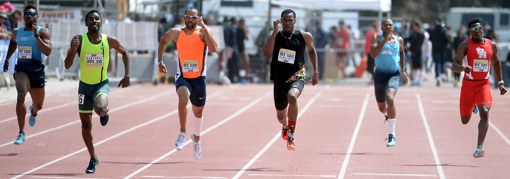 . Yousef Masrah, second from left, wins the 400 meter Dash Invitational Elite during the Mt. SAC Relays in Hilmer Lodge Stadium on the campus of Mt. San Antonio College in Walnut, Calif., on Saturday, April 19, 2014.  (Keith Birmingham Pasadena Star-News)