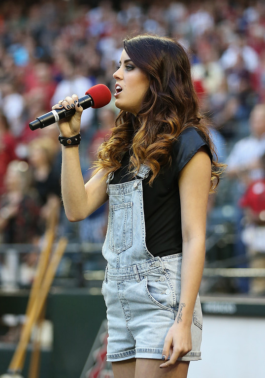 . Singer-songwriter Angie Miller performs the National Anthem before the Opening Day MLB game between the Arizona Diamondbacks and the San Francisco Giants at Chase Field on March 31, 2014 in Phoenix, Arizona.  (Photo by Christian Petersen/Getty Images)
