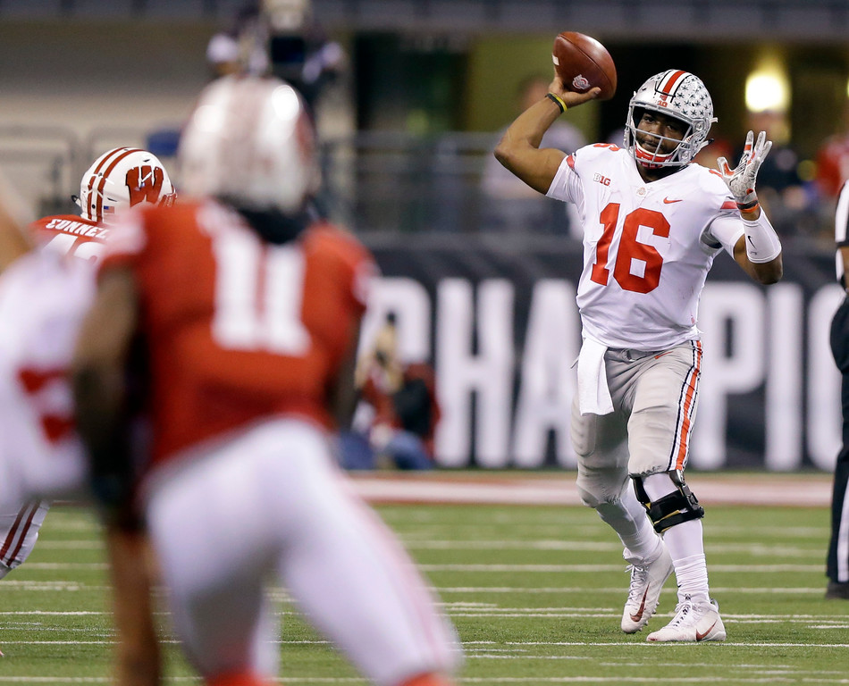 . Ohio State quarterback J.T. Barrett throws during the first half of the Big Ten championship NCAA college football game against Wisconsin, Saturday, Dec. 2, 2017, in Indianapolis. (AP Photo/Michael Conroy)