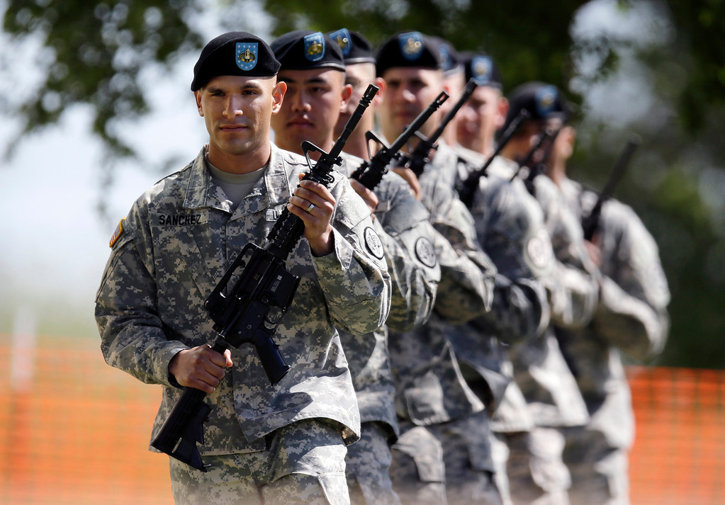 . Soldiers prepare for a service where President Barack Obama will attend, Wednesday, April 9, 2014, at Fort Hood, Texas. Last week\'s shooting rampage left four dead and more than a dozen injured.  (AP Photo/Eric Gay)