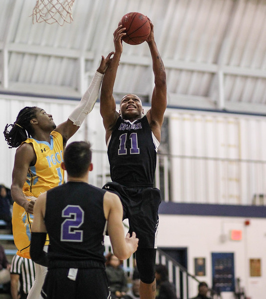 January 23, 2019: Montgomery forward Freddie Harris (11) grabs a rebound during JUCO mens basketball action between Montgomery Community College and Prince George's Community College in Largo. Photo by: Chris Thompkins/Prince Georges Sentinel