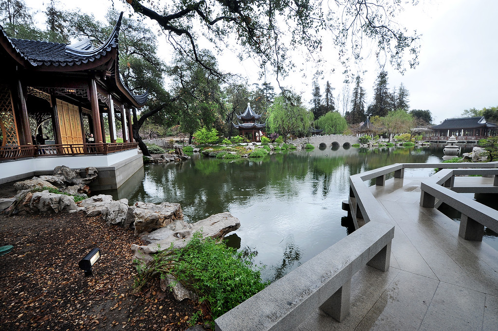 . Clear and Transcendent pavilion, left, at the The Huntington, whichTopened Phase I of the Chinese Garden in 2008. Now, about half way through Phase II, opened  a new section Friday, February 28, 2014, that includes a rock grotto, eloquently named Lingering Clouds Peak. that Visitors can walk through as water cascades from a stream overhead, and two new tile-roofed buildings: the Waveless Boat pavilion, facing a picturesque view of the existing Jade Ribbon Bridge across the lake, and the Clear and Transcendent pavilion, which will serve as a performance space. Artisans from Suzhou, China worked at The Huntington from November 2013 through January 2014,(Photo by Walt Mancini/Pasadena Star-News)