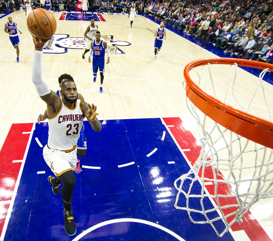 . Cleveland Cavaliers\' LeBron James goes up for the dunk with Philadelphia 76ers\' Joel Embiid trailing him during the second half of an NBA basketball game, Saturday, Nov. 5, 2016, in Philadelphia. The Cavaliers won 102-101. (AP Photo/Chris Szagola)