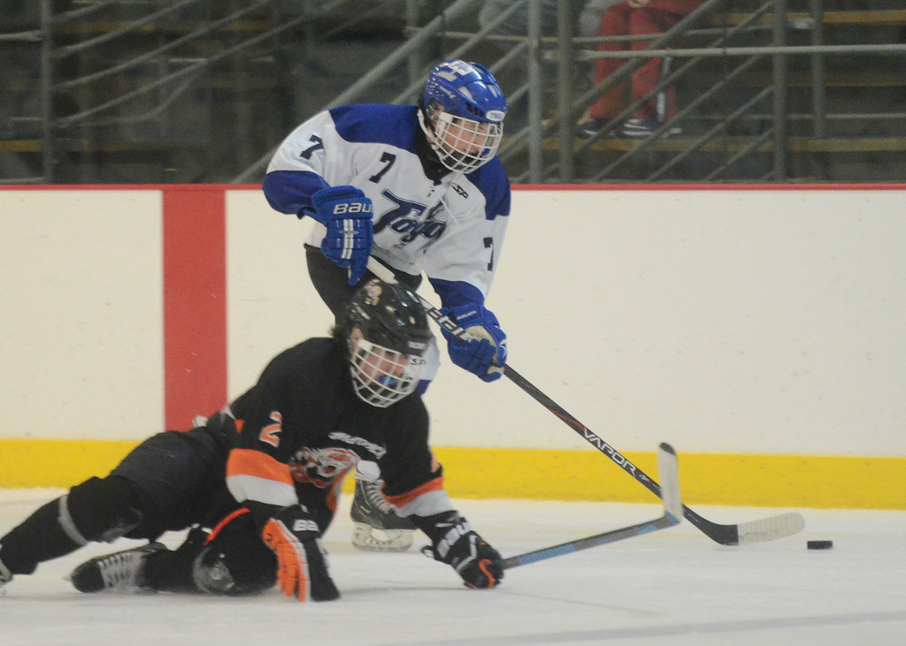 . Ed Burke - The Saratogian 12/06/13 Saratoga\'s Devin Coffey skates around Mamaroneck\'s Cooper Lavan Friday in the opening round of the Don Kauth Memorial Tournament.