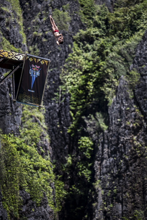 . In this handout image provided by Red Bull, Jonathan Paredes of Mexico dives from the 27 meter platform at Maya Bay in the Andaman Sea during the final stop of the 2013 Red Bull Cliff Diving World Series on October 22, 2013 at Phi Phi Island, Thailand. (Photo by Dean Treml/Red Bull via Getty Images)
