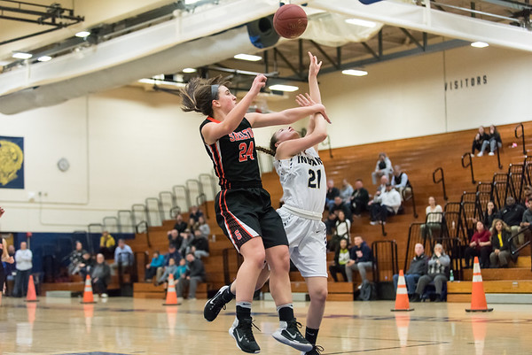 02/26/19 Wesley Bunnell | Staff Newington girls basketball vs Shelton in a CIAC playoff game played at home on Tuesday night. Aby Flores (21) is fouled by the Shelton defender but the bucket would count to put Newington up 53-49.
