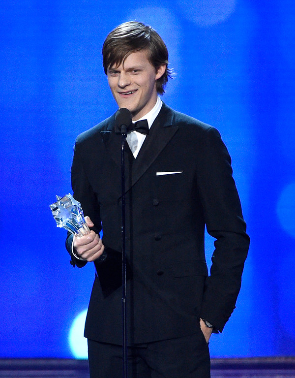""". Lucas Hedges accepts the award for best young actor/actress for \""""Manchester by the Sea\"""" at the 22nd annual Critics\' Choice Awards at the Barker Hangar on Sunday, Dec. 11, 2016, in Santa Monica, Calif. (Photo by Chris Pizzello/Invision/AP)"""