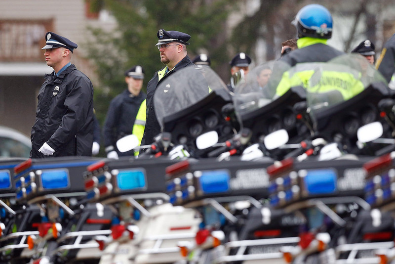 . Members of many different law enforcement agencies walk in formation into the funeral for the slain Massachusetts Institute of Technology (MIT) police officer Sean Collier at St Patrick\'s Church on April 23, 2013 in Stoneham, Massachusetts. Collier was allegedly shot by the suspects in the Boston Marathon bombing, Dzhokhar A. Tsarnaev, 19, and his brother Tamerlan Tsarnaev, 26, after their identities were determined and a manhunt was launched.  Tamerlan Tsarnaev was subsequently shot and killed after a car chase and shootout with police and Dzhokhar Tsarnaev was apprehended on a boat parked on a residential property in Watertown, Massachusetts. The bombing, on April 15 at the finish line of the marathon, killed three people and wounded at least 170.  (Photo by Jared Wickerham/Getty Images)