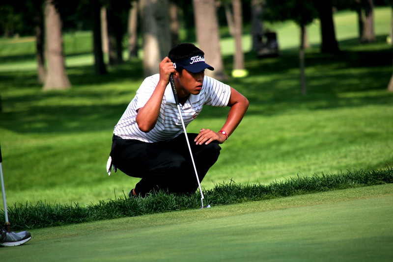 Jeffrey Kang, 20, of Fullerton, Calif., lines up a putt during his match against Andrew Putnam Friday afternoon.